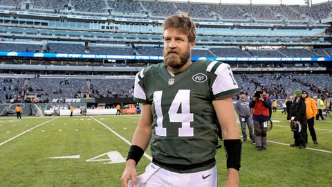 FILE - in this Jan. 1, 2017, file photo, New York Jets quarterback Ryan Fitzpatrick walks off the field after the team's NFL football game against the Buffalo Bills in East Rutherford, N.J. Fitzpatrick's contract with the Jets has voided, as expected, making the veteran quarterback a free agent. Fitzpatrick re-signed with the Jets last July on a one-year, $12 million deal. Technically, the contract was for two years, but contained language in which the second year would be automatically voided five days after the Super Bowl--meaning, Friday--if Fitzpatrick remained on the roster. (AP Photo/Bill Kostroun, File)