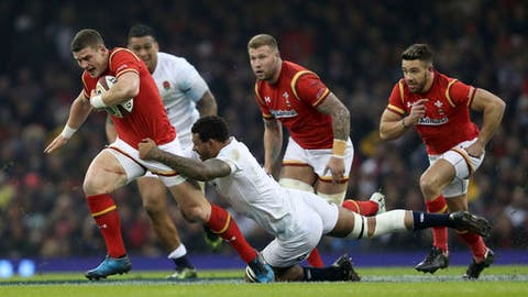 Wales' Scott Williams, left, is tackled by England's Courtney Lawes during the Six Nations rugby match Wales against England at the Principality Stadium, Cardiff, Wales, Saturday Feb. 11, 2017. (David Davies/PA via AP)