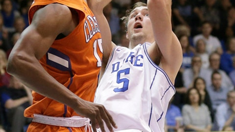 Duke's Luke Kennard (5) shoots while Clemson's Donte Grantham defends during the second half of an NCAA college basketball game in Durham, N.C., Saturday, Feb. 11, 2017. Duke won 64-62. (AP Photo/Gerry Broome)