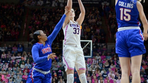 Connecticut's Katie Lou Samuelson shoots between SMU's Mikayla Reese, left, and Stephanie Collins, right, in the first half of an NCAA college basketball game, Saturday, Feb. 11, 2017, in Storrs, Conn. (AP Photo/Jessica Hill)