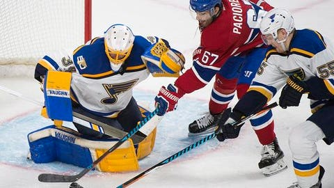 Montreal Canadiens left wing Max Pacioretty (67) moves in on St. Louis Blues goalie Jake Allen (34) as Blues' Colton Parayko (55) defends during the third period of an NHL hockey game Saturday, Feb. 11, 2017, in Montreal. (Graham Hughes/The Canadian Press via AP)
