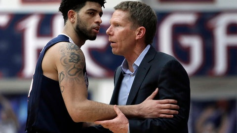 Gonzaga's Josh Perkins, left, speaks with coach Mark Few during the second half of the team's NCAA college basketball game against Saint Mary's Saturday, Feb. 11, 2017, in Moraga, Calif. (AP Photo/Ben Margot)