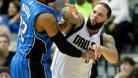 Dallas Mavericks guard Deron Williams (8) passes against Orlando Magic guard C.J. Watson (32) during the first half of an NBA basketball game in Dallas, Saturday, Feb. 11, 2017. (AP Photo/LM Otero)