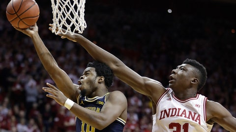 Michigan's Derrick Walton Jr. shoots against Indiana's Thomas Bryant during the first half of an NCAA college basketball game Sunday, Feb. 12, 2017, in Bloomington, Ind. (AP Photo/Darron Cummings)