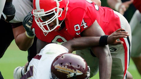 Louisiana-Monroe quarterback Steven Jyles goes down after fumbling on a hit by Georgia's Quentin Moses (94) in the third quarter Saturday, Sept. 17, 2005 in Athens, Ga. Georgia recovered the ball in the end zone for a touchdown and went on to win 44-7.  (AP Photo/John Bazemore)