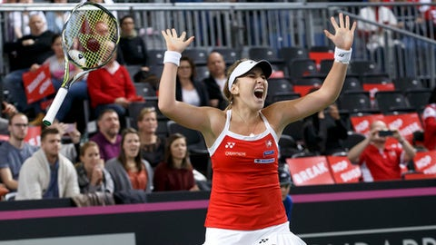 Belinda Bencic of Switzerland celebrates her victory after beating Pauline Parmentier of France, during the fourth single tennis match of the Fed Cup World Group first round match between Switzerland and France, at Palexpo, in Geneva, Switzerland, on Sunday, Feb. 12, 2017.  (Salvatore Di Nolfi/Keystone via AP)