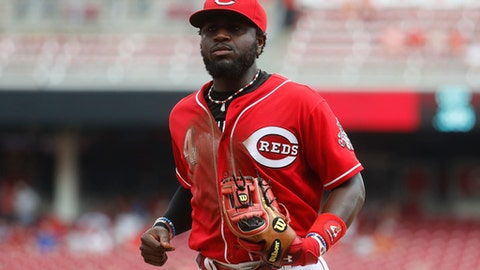 Cincinnati Reds second baseman Brandon Phillips runs back to the dugout in the eighth inning of a baseball game against the St. Louis Cardinals, Thursday, Aug. 4, 2016, in Cincinnati. The Reds won 7-0. (AP Photo/John Minchillo)