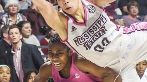 Mississippi State guard Dominique Dillingham (00) fouls Mississippi guard Erika Sisk (5) during an NCAA college basketball game in Oxford, Miss., Sunday, Feb. 12, 2017. (Bruce Newman/Oxford Eagle via AP)