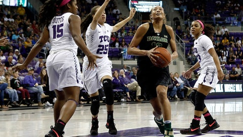 Baylor's Alexis Prince (12) drives against TCU's Jada Butts (15), Kianna Ray (25) and AJ Alix (23) during the first half of an NCAA college basketball game, Sunday, Feb., 12, 2017, in Fort Worth, Texas. (AP Photo/Mike Stone)