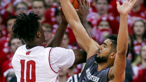 Wisconsin's Nigel Hayes (10) shoots against Indiana's Sanjay Lumpkin (34) during the first half of an NCAA college basketball game Sunday, Feb. 12, 2017, in Madison, Wis. (AP Photo/Andy Manis)