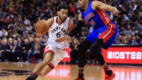 TORONTO, ON - FEBRUARY 12:  Cory Joseph #6 of the Toronto Raptors dribbles the ball as Tobias Harris #34 of the Detroit Pistons defends during the second half of an NBA game at Air Canada Centre on February 12, 2017 in Toronto, Canada.  NOTE TO USER: User expressly acknowledges and agrees that, by downloading and or using this photograph, User is consenting to the terms and conditions of the Getty Images License Agreement.  (Photo by Vaughn Ridley/Getty Images)