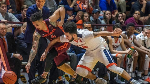 Virginia Tech guard Seth Allen (4) tries to steal the ball from Virginia guard London Perrantes (32) as Virginia head coach Tony Bennett, behind Allen, looks on in the first overtime of an NCAA college basketball game against Virginia Tech in Blacksburg, Va., Sunday, Feb. 12, 2017. Virginia Tech won, 80-78, in double overtime. (AP Photo/Don Petersen)