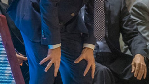 Virginia head coach Tony Bennett yells to his players in the first half of an NCAA college basketball game against Virginia Tech in Blacksburg, Va., Sunday, Feb. 12, 2017. Virginia Tech won, 80-78, in double overtime. (AP Photo/Don Petersen)