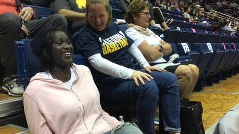 "Former California women's basketball player Rama N'diaye, left, and athletic trainer Ann Caslin share a light moment before the NCAA college basketball's California home game with Colorado in Berkeley, Calif., Sunday, Feb. 12, 2017. Diagnosed last July with Stage 2 breast cancer, N'diaye had been playing pickup basketball six months earlier when she first felt a small lump in her right breast. When N'diaye heard the fundraising effort was called ""Rebounds For Rama,"" she knew right away Caslin was behind it. (AP Photo/Janie McCauley)"