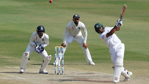 Bangladesh's Mahmudullah, right, plays a shot during the last day of a one-off cricket test match against India in Hyderabad, India, Monday, Feb. 13, 2017. (AP Photo/Aijaz Rahi)