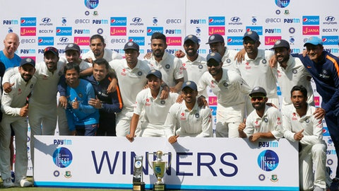 Members of Indian team pose with the winning trophy after their win over Bangladesh in their one-off cricket test match in Hyderabad, India, Monday, Feb. 13, 2017. India won the match by 208 runs. (AP Photo/Aijaz Rahi)