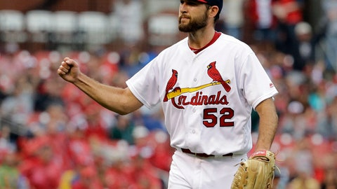 FILE - In this Sunday, July 3, 2016, file photo, St. Louis Cardinals starting pitcher Michael Wacha pumps his fist after getting Milwaukee Brewers' Aaron Hill to ground into a double play to end the top of the fifth inning of a baseball game in St. Louis. Jake Odorizzi of Tampa Bay and Wacha of St. Louis have gone to salary arbitration and are among six first-time eligible starting pitchers who could get decisions Tuesday, Feb. 14, 2017. (AP Photo/Jeff Roberson, File)