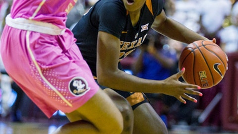 Texas guard Ariel Atkins brings the ball up court against Florida State in the first half of an NCAA college basketball game in Tallahassee, Fla., Monday, Feb. 13, 2017. (AP Photo/Mark Wallheiser)