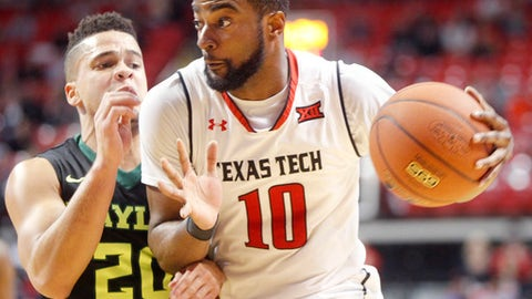 Texas Tech guard Niem Stevenson drives around Baylor guard Manu Lecomte during the first period of an NCAA college basketball game Monday, Feb. 13, 2017, in Lubbock, Texas. (AP Photo/Mark Rogers)