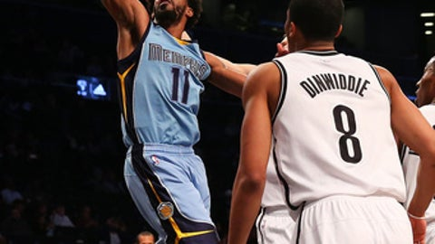 NEW YORK, NY - FEBRUARY 13:  Mike Conley #11 of the Memphis Grizzlies drives to the net against the Brooklyn Nets at Barclays Center on February 13, 2017 in Brooklyn borough of New York City. NOTE TO USER: User expressly acknowledges and agrees that, by downloading and or using this photograph, User is consenting to the terms and conditions of the Getty Images License Agreement.  (Photo by Mike Stobe/Getty Images)