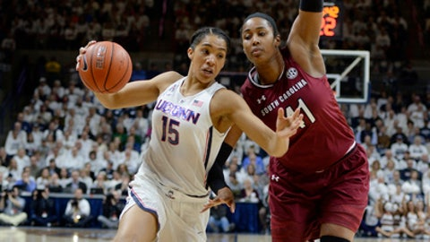Connecticut's Gabby Williams drives to the basket as South Carolina's Alaina Coates, right, defends, in the first half of an NCAA college basketball game, Monday, Feb. 13, 2017, in Storrs, Conn. (AP Photo/Jessica Hill)
