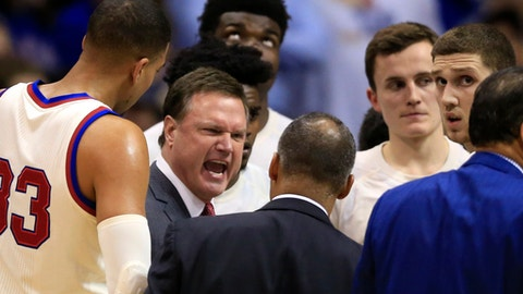 Kansas head coach Bill Self yells at his team during a timeout in the first half of an NCAA college basketball game against West Virginia in Lawrence, Kan., Monday, Feb. 13, 2017. (AP Photo/Orlin Wagner)