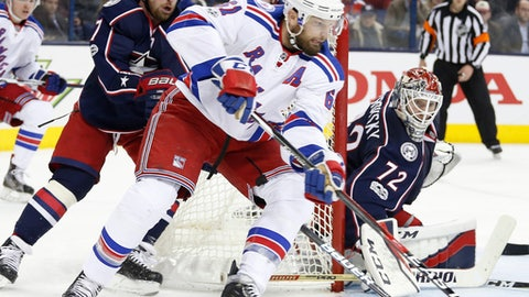 New York Rangers' Rick Nash, center, takes a shot against Columbus Blue Jackets' Sergei Bobrovsky, right, of Russia, as Brandon Dubinsky defends during the third period of an NHL hockey game Monday, Feb. 13, 2017, in Columbus, Ohio. The Rangers beat the Blue Jackets 3-2. (AP Photo/Jay LaPrete)