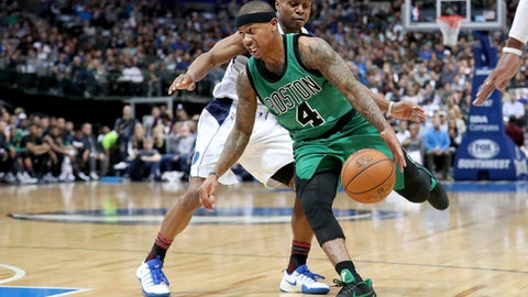 DALLAS, TX - FEBRUARY 13:  Isaiah Thomas #4 of the Boston Celtics drives to the basket against Yogi Ferrell #11 of the Dallas Mavericks in the first half at American Airlines Center on February 13, 2017 in Dallas, Texas. NOTE TO USER: User expressly acknowledges and agrees that, by downloading and or using this photograph, User is consenting to the terms and conditions of the Getty Images License Agreement.  (Photo by Tom Pennington/Getty Images)