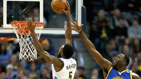DENVER, CO - FEBRUARY 13:  Will Barton #5 of the Denver Nuggets puts in a basket against Draymond Green #23 of the Golden State Warriors at the Pepsi Center on February 13, 2017 in Denver, Colorado. NOTE TO USER: User expressly acknowledges and agrees that , by downloading and or using this photograph, User is consenting to the terms and conditions of the Getty Images License Agreement.  (Photo by Matthew Stockman/Getty Images)