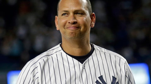FILE - In this Aug. 12, 2016, file photo, New York Yankees' Alex Rodriguez smiles during a ceremony prior to his final baseball game with the team, against the Tampa Bay Rays in New York. Rodriguez and Nick Swisher are joining the group of guest instructors at Yankees' spring training this year. (AP Photo/Adam Hunger, File)