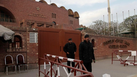 Private guards stand alert outside the Gadaffi cricket stadium, a venue for the upcoming final of the Pakistan Super League in Lahore, Pakistan, Tuesday, Feb. 14, 2017. Pakistan cricket fans fear foreign players will avoid competing in the Pakistan Super League final in Lahore after a suicide bomber killed 13 people there on Monday. The five-team PSL began last week in the United Arab Emirates, and the final on March 5 is set for Lahore. (AP Photo/K.M. Chaudary)