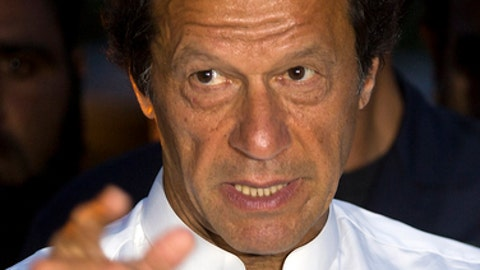 """FILE -- In this Monday, April 11, 2016 file photo, Pakistan's former cricketer turned politician talks to reporters in Islamabad, Pakistan. Khan said that """"I wanted the whole Pakistan Super League in Pakistan, not only just the final,"""" """"But the problem is that when terrorism happens, it gets highlighted more, and foreigners get scared."""" (AP Photo/B.K. Bangash,file)"""