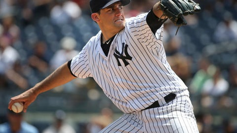 FILE - In this Sunday, July 24, 2016, file photo, New York Yankees starting pitcher Nathan Eovaldi throws during the first inning of the baseball game against the San Francisco Giants at Yankee Stadium in New York. The Tampa Bay Rays have finalized a $2 million, one-year contract with injured pitcher Nathan Eovaldi. The 27-year-old right-hander is expected to miss the 2017 season while recovering from Tommy John surgery last August, when he was with the New York Yankees. (AP Photo/Seth Wenig, File)