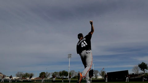 San Francisco Giants relief pitcher Mark Melancon warms up during spring baseball practice in Scottsdale, Ariz., Tuesday, Feb. 14, 2017. (AP Photo/Chris Carlson)
