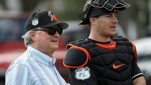 Miami Marlins owner Jeffrey Loria, right, watches with catcher J.T. Realmuto during a spring training baseball workout Tuesday, Feb. 14, 2017, in Jupiter, Fla. (AP Photo/David J. Phillip)