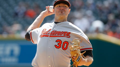 Baltimore Orioles pitcher Chris Tillman throws against the Detroit Tigers in the first inning of a baseball game in Detroit, Sunday, Sept. 11, 2016. (AP Photo/Paul Sancya)