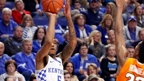 Kentucky's Malik Monk takes a three point shot under pressure from Tennessee's Jordan Bowden (23) during the first half of an NCAA college basketball game, Tuesday, Feb. 14, 2017, in Lexington, Ky. (AP Photo/James Crisp)