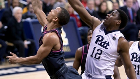 Virginia Tech's Justin Robinson, left, shoots as Pittsburgh's Chris Jones (12) defends during the second half of an NCAA college basketball game, Tuesday, Feb. 14, 2017, in Pittsburgh. (AP Photo/Keith Srakocic)