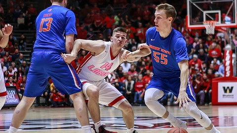 Boise State's David Walker (55) dribbles around New Mexico's Dane Kuiper (14) during the first half of an NCAA college basketball game in Albuquerque, N.M., Tuesday, Feb. 14, 2017. (AP Photo/Juan Antonio Labreche)