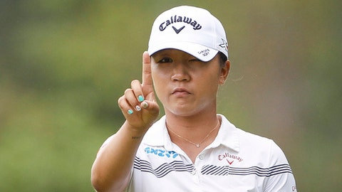 FILE - In this Oct. 28, 2016 file photo, Lydia Ko of New Zealand checks her line on the eleventh green during the second round of the LPGA golf tournament at Tournament Players Club (TPC) in Kuala Lumpur, Malaysia. A day ahead of the start of the Women's Australian Open at Royal Adelaide, the 21-year-old Thai golfer Ariya Jutanugarn also says she's not putting pressure on herself to overtake Ko for the No. 1 ranking. (AP Photo/Joshua Paul, File)