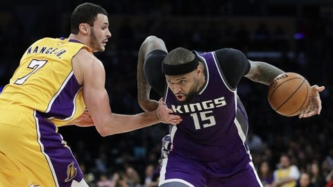 Sacramento Kings' DeMarcus Cousins, right, drives past Los Angeles Lakers' Larry Nance Jr. during the second half of an NBA basketball game, Tuesday, Feb. 14, 2017, in Los Angeles. The Kings won 97-96. (AP Photo/Jae C. Hong)