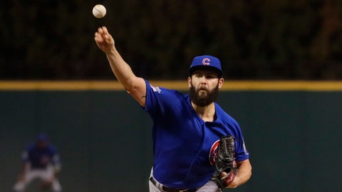 Chicago Cubs starting pitcher Jake Arrieta throws during the first inning of Game 6 of the Major League Baseball World Series against the Cleveland Indians Tuesday, Nov. 1, 2016, in Cleveland. (AP Photo/Jamie Squire, Pool)