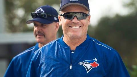 Toronto Blue Jays manager John Gibbons smiles as he enters the training facility during baseball spring training in Dunedin, Fla., Wednesday, Feb. 15, 2017. (Nathan Denette/The Canadian Press via AP)