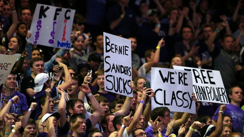 Kansas State fans hold signs during a timeout in the second half of Kansas State's NCAA college basketball game against Kansas in Manhattan, Kan., Saturday, Feb. 20, 2016. Kansas defeated Kansas State 72-63(AP Photo/Orlin Wagner)