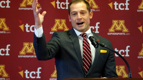 New University of Minnesota head football coach for the NCAA Golden Gophers addresses the media after he was introduced during a news conference Friday, Jan.7, 2017, in Minneapolis. He replaces Tracy Claeys who was fired earlier in the week. (AP Photo/Jim Mone)