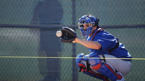 Chicago Cubs catcher Miguel Montero catches a ball during a spring training baseball workout Tuesday, Feb. 14, 2017, in Mesa, Ariz. (AP Photo/Morry Gash)