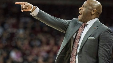 Arkansas head coach Mike Anderson communicates with players during the first half of an NCAA college basketball game against South Carolina, Wednesday, Feb. 15, 2017, in Columbia, S.C. (AP Photo/Sean Rayford)