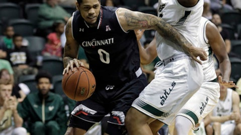 Cincinnati forward Quadri Moore (0) drives around South Florida forward Luis Santos during the first half of an NCAA college basketball game Wednesday, Feb. 15, 2017, in Tampa, Fla. (AP Photo/Chris O'Meara)