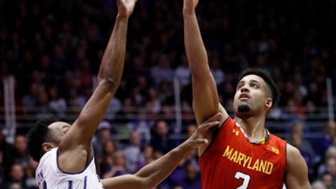Maryland guard Melo Trimble, right, shoots against Northwestern guard Isiah Brown during the first half of an NCAA college basketball game Wednesday, Feb. 15, 2017, in Evanston, Ill. (AP Photo/Nam Y. Huh)