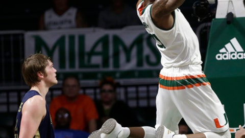 Miami's Kamari Murphy, right, dunks in front of Georgia's Ben Lammers during the first half of an NCAA college basketball game, Wednesday, Feb. 15, 2017, in Coral Gables, Fla. (AP Photo/Lynne Sladky)